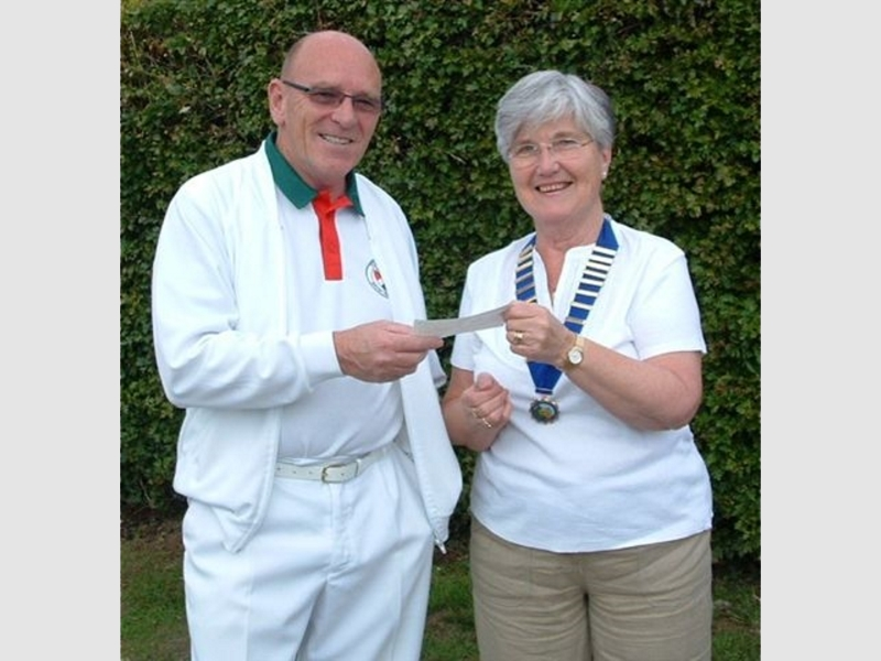 Chairman receiving Community Council Donation from Chairperson Mrs Rosa Patter